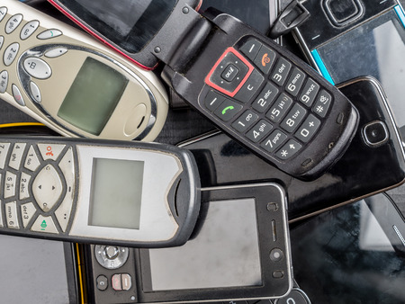 wireless telephone: Pile of old and used mobile phones Stock Photo