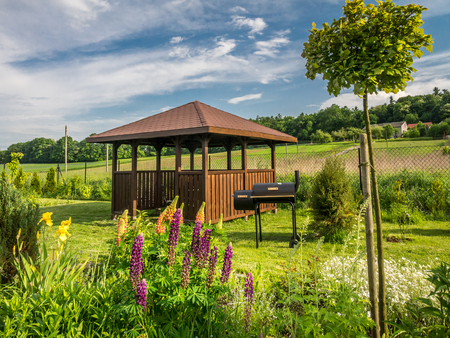 Wooden Summer House With Grill In The Backyard Photo