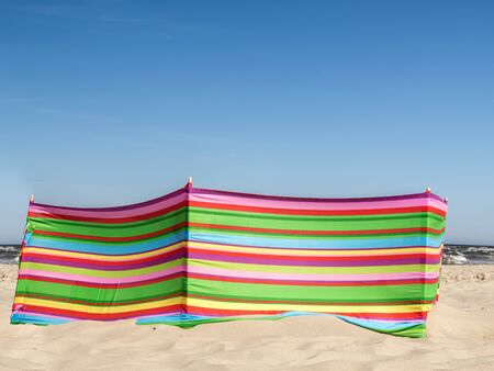 baffle: Colorful striped windbreak at the beach