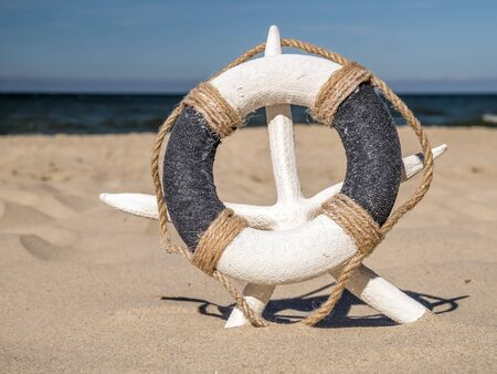 life buoy: Life buoy placed on white starfish stuck on the sand beach against the sea
