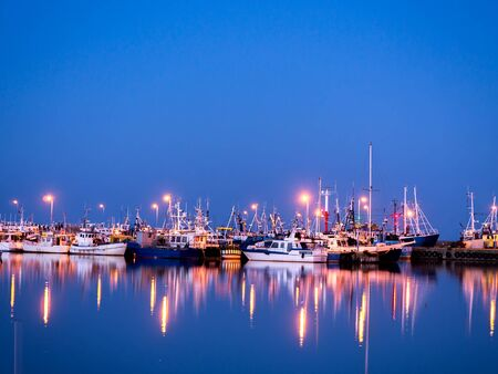 berth: Fishing port at twilight with reflections