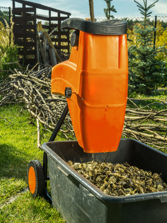 shredder machine: Electric wood shredder with wood chips used for garden mulching