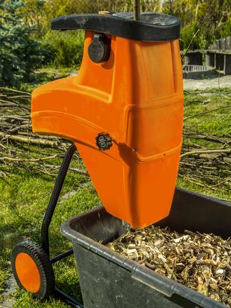 garden mulcher. Electric Wood Shredder With Chips Used For Garden Mulching Photo Mulcher E