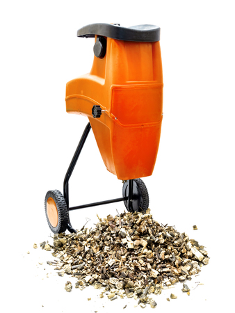 Electric wood shredder with wood chips used for garden mulching shot on white Stock Photo
