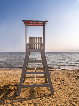 life guard stand: Empty wooden lifeguard post shot against the sea with clear blue sky