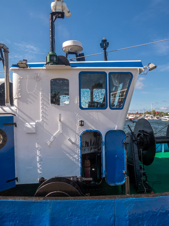 wheelhouse: Closeup of cutter berthing at the harbour