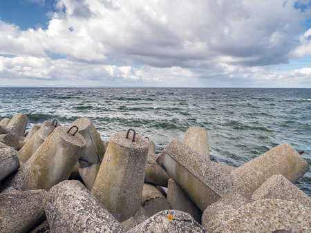 breakers: Massive concrete breakers stacked on the coastline