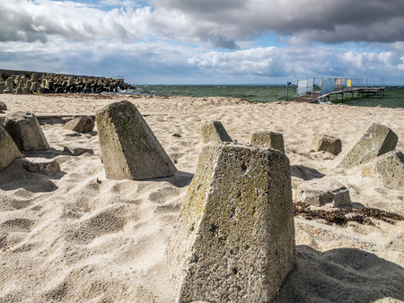 breakers: Massive concrete breakers stacked on the beach Stock Photo