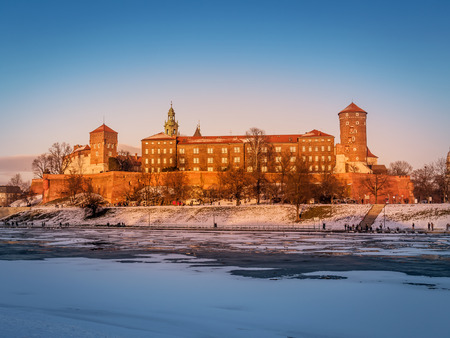 Royal Wawel Castle in winter time with ice floe on the Vistula river, Krakow - Poland Stock Photo