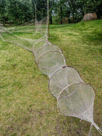 Old fishnets exhibited in heritage park in Kluki, near Slowinski National Park, Poland Stock Photo