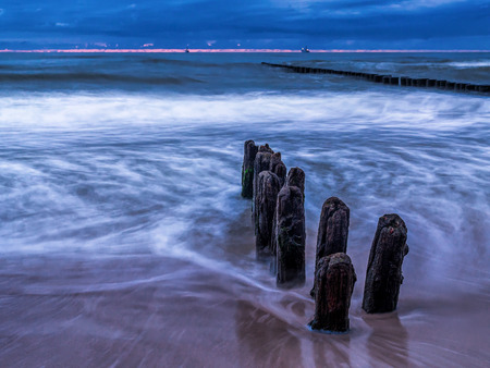 Old and weathered wooden wave breakers, Ustka, Baltic Sea, Poland  Stock Photo