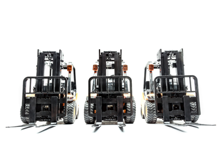 Three forklift truck parked in a row shot on white background Stock Photo