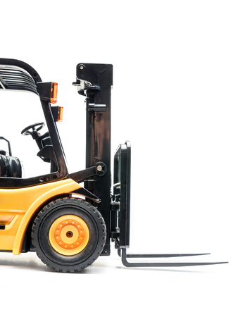 Side shot of yellow forklift truck on white background