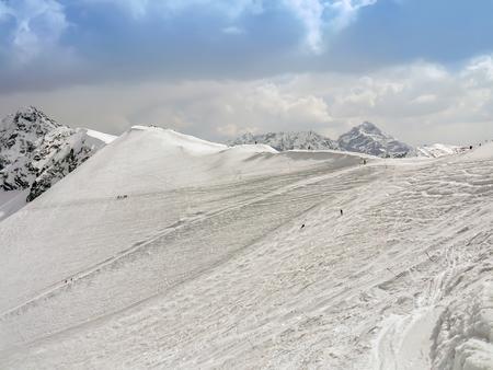 Group of tourists climbing Tatra mountain summit in winter
