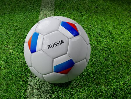 3D rendering of white soccer ball with imprinted Russian flag colors placed next to the pitch line Stock Photo