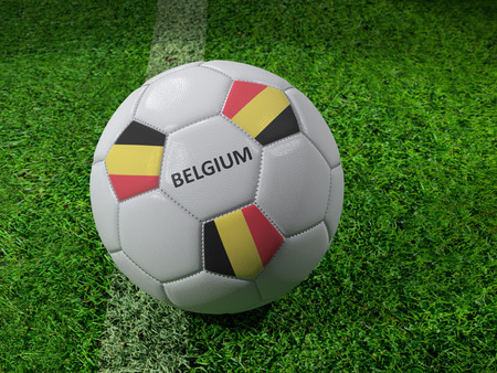 3D rendering of white soccer ball with imprinted Belgium flag colors placed next to the pitch line