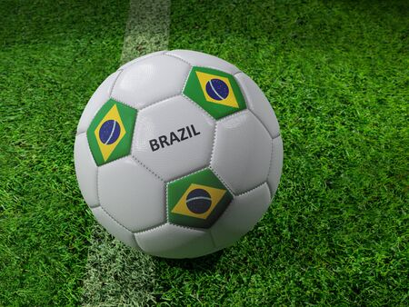 3D rendering of white soccer ball with imprinted Brazil flag colors placed next to the pitch line Stock Photo