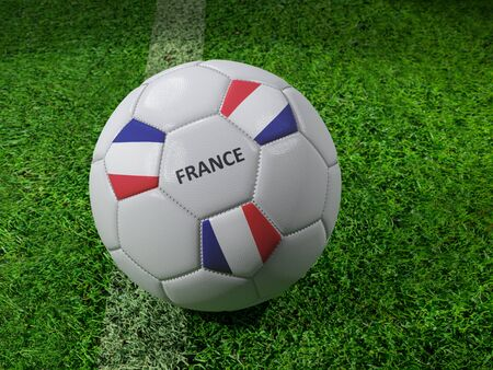 3D rendering of white soccer ball with imprinted France flag colors placed next to the pitch line
