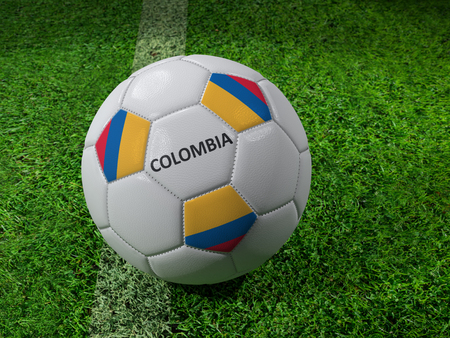 3D rendering of white soccer ball with imprinted Colombia flag colors placed next to the pitch line