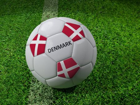 3D rendering of white soccer ball with imprinted Denmark as flag colors placed next to the pitch line Stock Photo