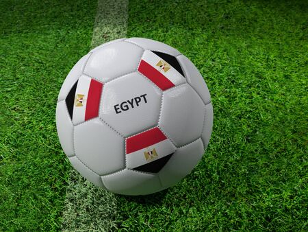 3D rendering of white soccer ball with imprinted Egypt as flag colors placed next to the pitch line