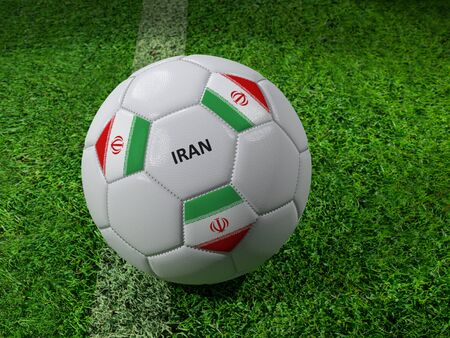 3D rendering of white soccer ball with imprinted Iran as flag colors placed next to the pitch line Stock Photo