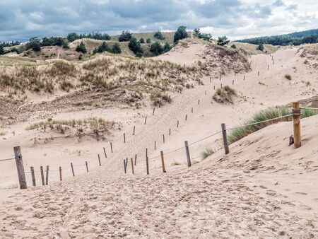Sandy trail withing the moving dune Wydma Czolpinska in the the Slowinski National Park, Poland Stock Photo