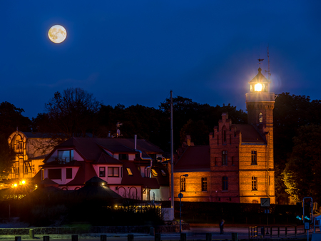 Historical Lighthouse in Ustka by night, located at the Baltic Sea coast, Poland  Stock Photo