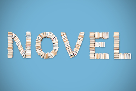 NOVEL word formed from books, shot from above on light blue background Stock Photo