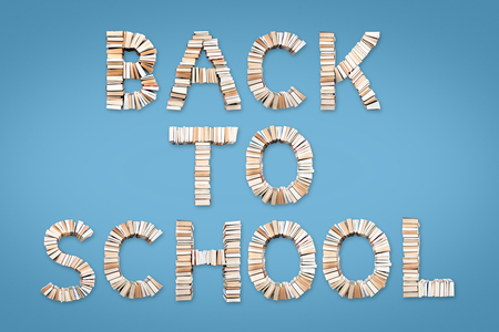 BACK TO SCHOOL phrase formed from books, shot from above on light blue background