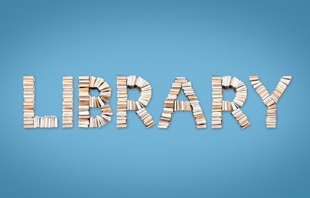 LIBRARY word formed from books, shot from above on light blue background Stock Photo