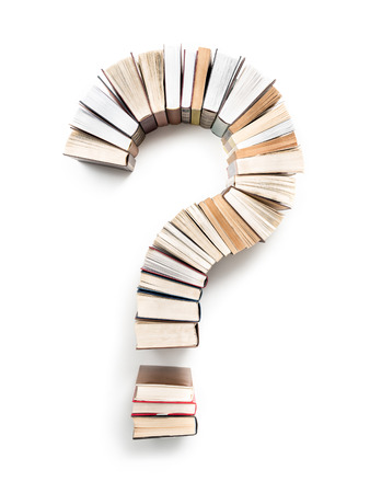 Question Mark formed from books, shot from above on white background
