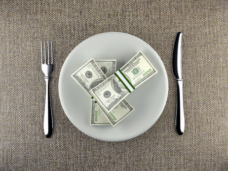 Wads of American 100 dollar bills served on plate with fork and knife placed on table - business concept