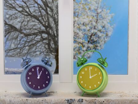 3D render of two alarm clocks indicating wintertime and springtime placed on windowsill with two pane-window showing outdoor growing tree in winter and spring scenery - time saving concept