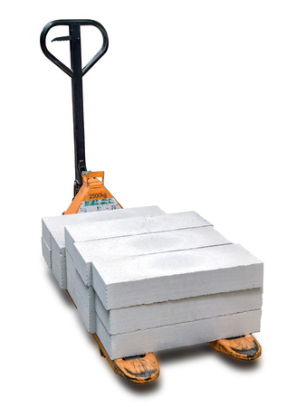 Pallet truck with autoclaved cellular concrete blocks shot over white background