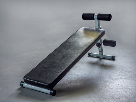 Simple workout bench on gray floor