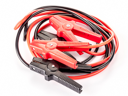 Black and red twisted jumper cables shot over white Stock Photo