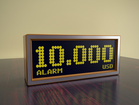 Modern alarm clock on wooden table displaying 10000 USD amount - business concept