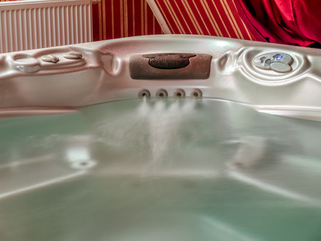 Closeup of jacuzzi filled with water Stock Photo