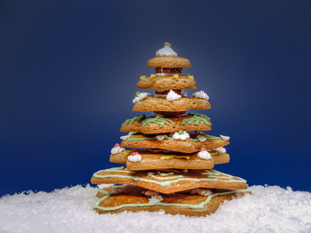 Gingerbread christmas tree over dark blue background Stock Photo