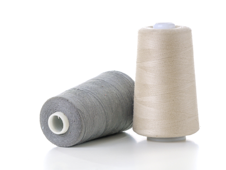 Two cotton thread spools isolated on a white background