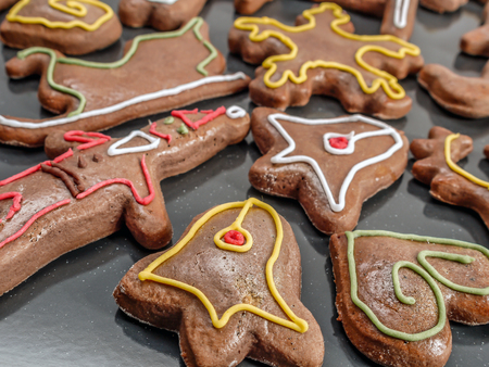 Seasonal shaped gingerbread cookies with colorful icing Stock Photo