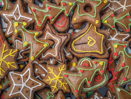 Pile of seasonal shaped gingerbread cookies shot from above