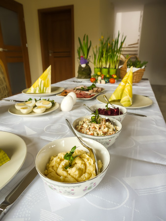 Traditional Polish Easter breakfast table with seasonal food and decorations Stock Photo