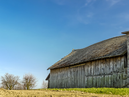 Old wooden weatherd barn with rural surrounding