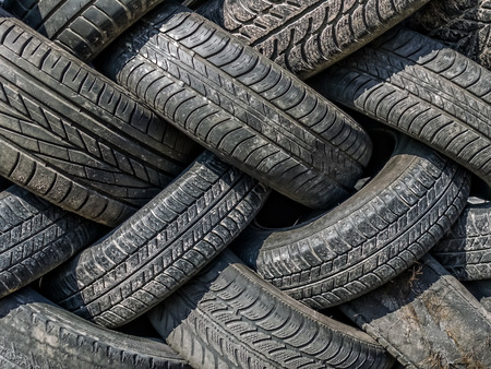 Piles of used and worn car tires