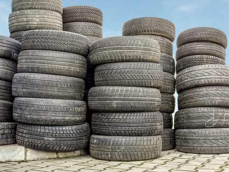 Piled used and worn car tires Stock Photo