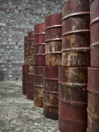 Pile of old rusty metal barrels in old storehouse