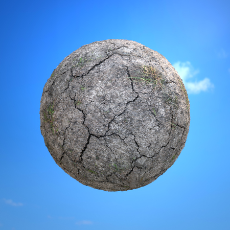 Dried and cracked little planet over blue sky - global warming concept 스톡 콘텐츠