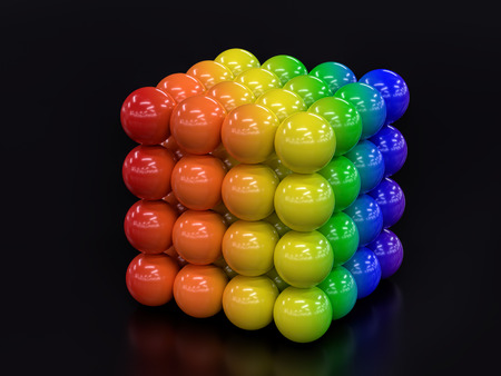 3D render of cube formed from balls in rainbow colors on black background